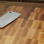 butcher block cutting board with cleaver
